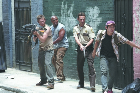 """Above, cast members of AMC's """"Walking Dead"""" series are shown in a scene. (Photo credit: AMC)"""