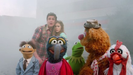 "Jason Segel and Amy Adams are shown with a group of Muppets from ""The Muppets."" (Photo credit: Walt Disney Pictures)"