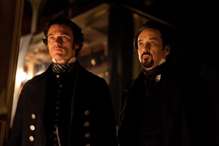 "Luke Evans, left, and John Cusack are shown in a scene from ""The Raven."" (Photo credit: Relativity Media)"