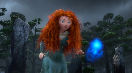"Princess Merida, voiced by actress Kelly Macdonald, follows a Wisp in a scene from the animated feature ""Brave."" (AP photo by Disney-Pixar Animation)"