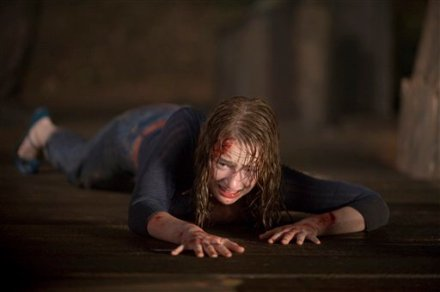"Kristen Connolly is shown in a scene from ""The Cabin in the Woods."" (Photo credit: AP photo by Lionsgate, Diyah Pera)"