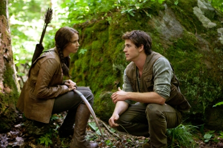 "Jennifer Lawrence portrays Katniss Everdeen, left, and Liam Hemsworth portrays Gale Hawthorne in a scene from ""The Hunger Games."" (Photo credit: AP photo by Lionsgate, Murray Close)"