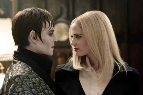 """Johnny Depp, left, and Eva Green are shown in a scene from """"Dark Shadows."""" (Photo credit: Warner Bros.)"""