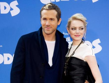Above, Ryan Reynolds and Emma Stone. (Photo credit: AP photo)