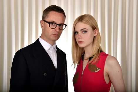 "Director Nicolas Winding Refn (left) poses with actress Elle Fanning to promote their film, ""The Neon Demon,"" in Los Angeles. (Photo credit: Jordan Strauss/Invision/AP)"